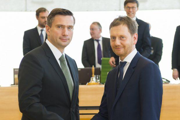 Martin Dulig (SPD) und Michael Kretschmer (CDU) bei der Amtseinführung von Michael Kretschmer 2018. Foto: Freistaat Sachsen, Matthias Rietschel