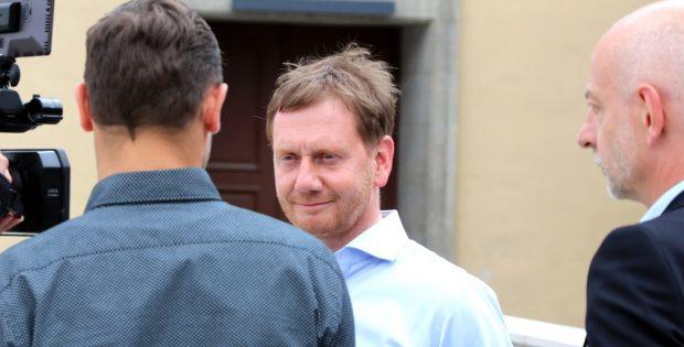 Michael Kretschmer bei der umstrittenen Klimakonferenz am 22. Juni 2019 in Leipzig. Foto: Michael Freitag