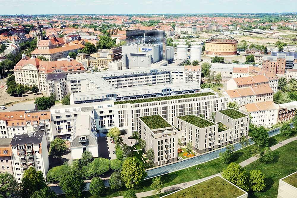 Quartiersübersicht mit dem geplante Radisson Hotel vorn im Bild. Visualisierung: FAY Projects