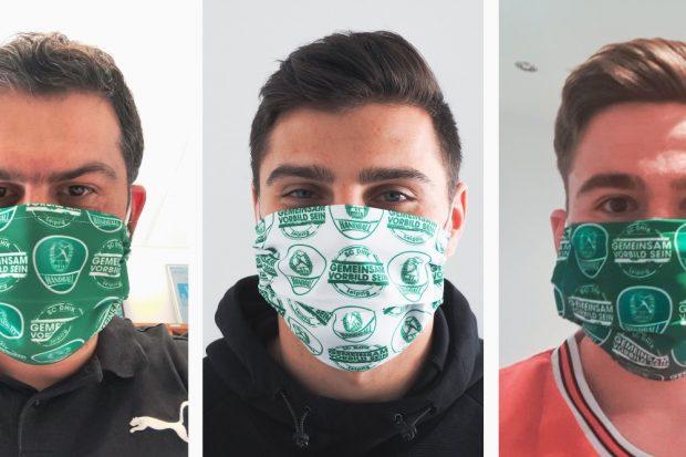 Geschäftsführer Karsten Günther, Rechtsaußen Lucas Krzikalla und Linksaußen Lukas Binder mit den SC DHfK Gesichtsmasken. Quelle: SC DHfK